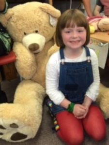 Lily who won Dougal the bear in the raffle.